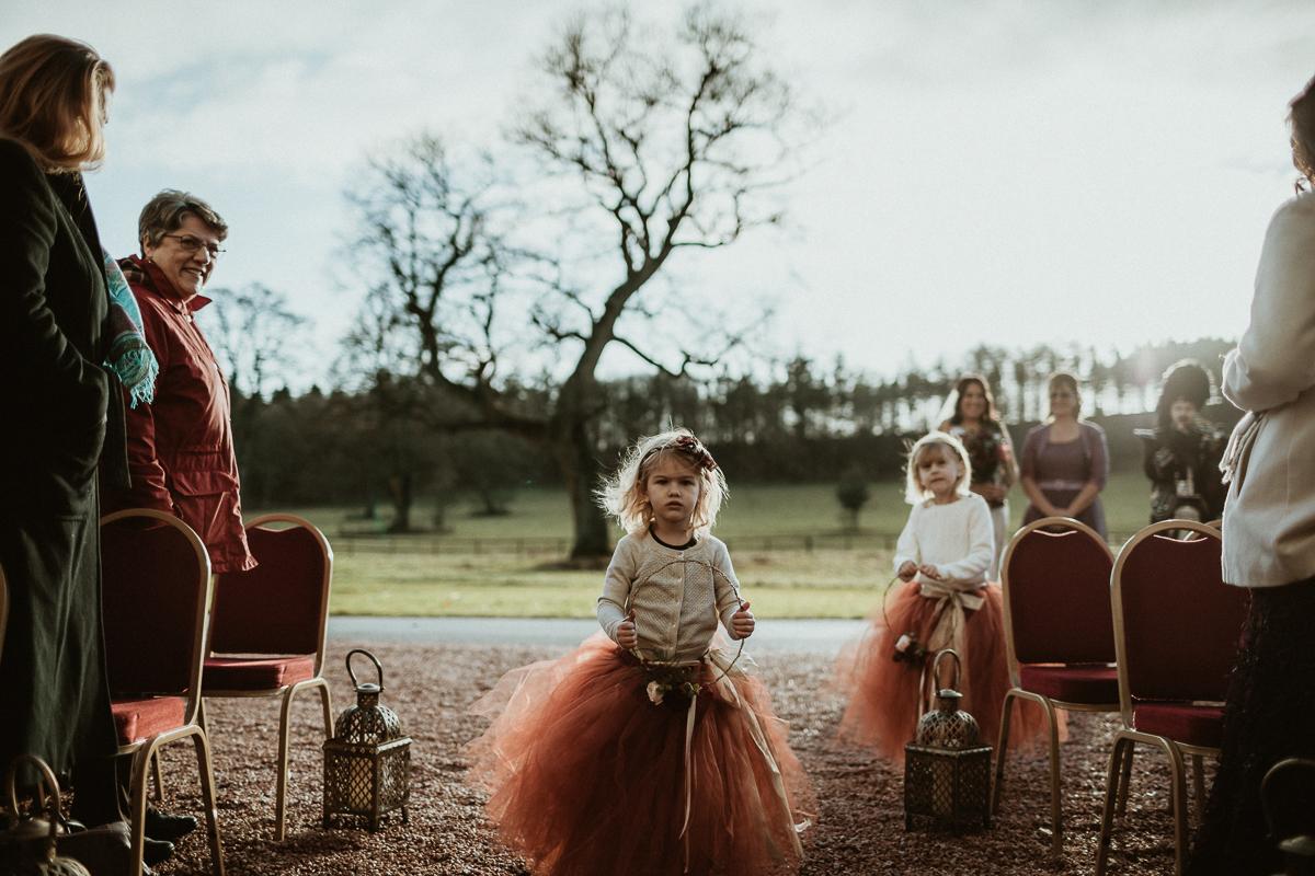 Cute flower girl during wedding ceremony at Castle Fraser