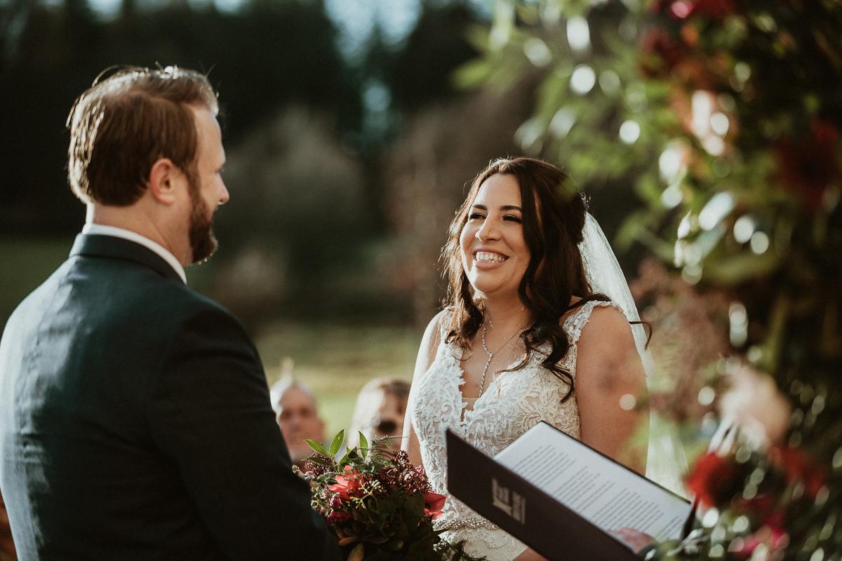 happy bride during ceremony