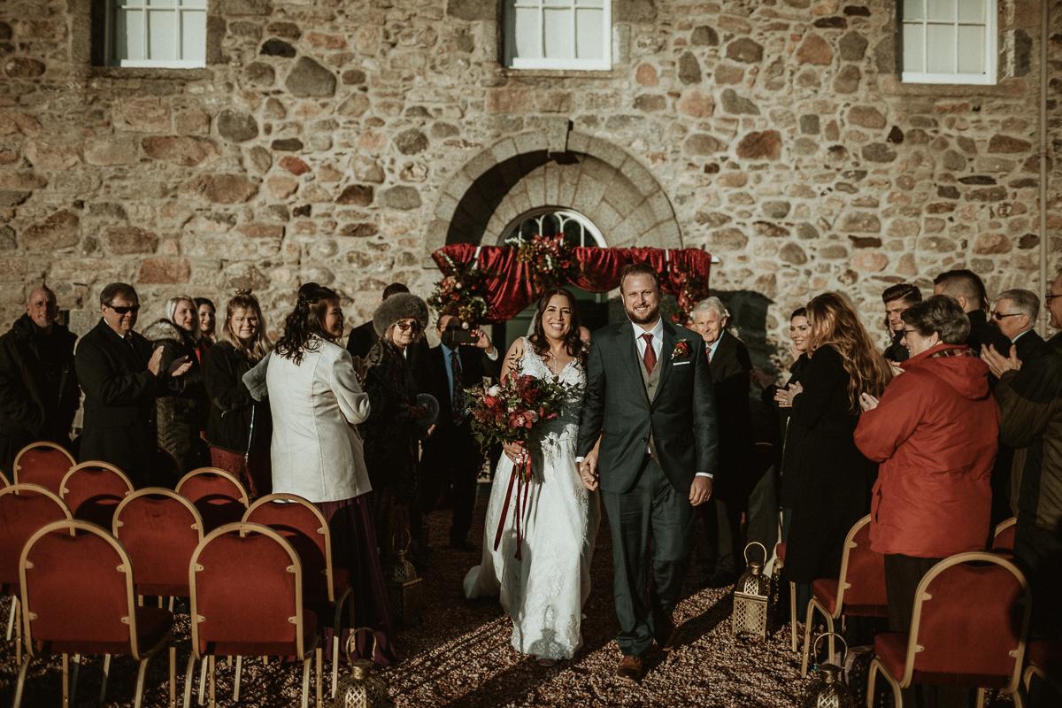 Bride and Groom after wedding at Castle Fraser