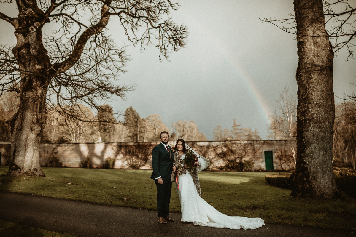 Rainbow over Bride and groom after their wedding