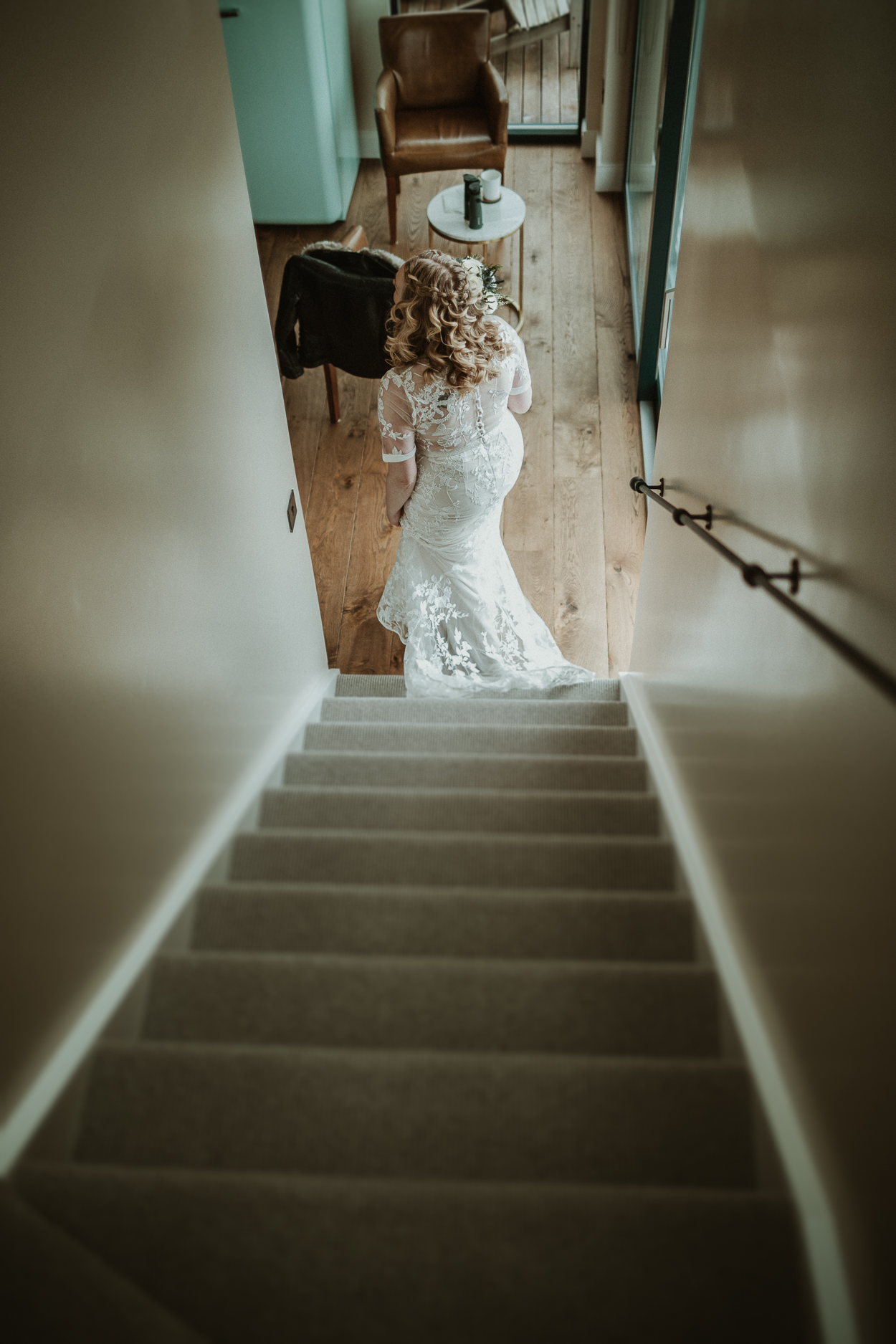 Bride walking down the stairs at the sheep station