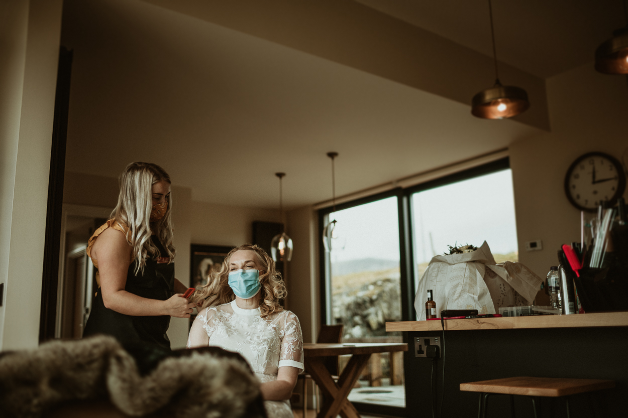 bride in a wedding dress having her hair done